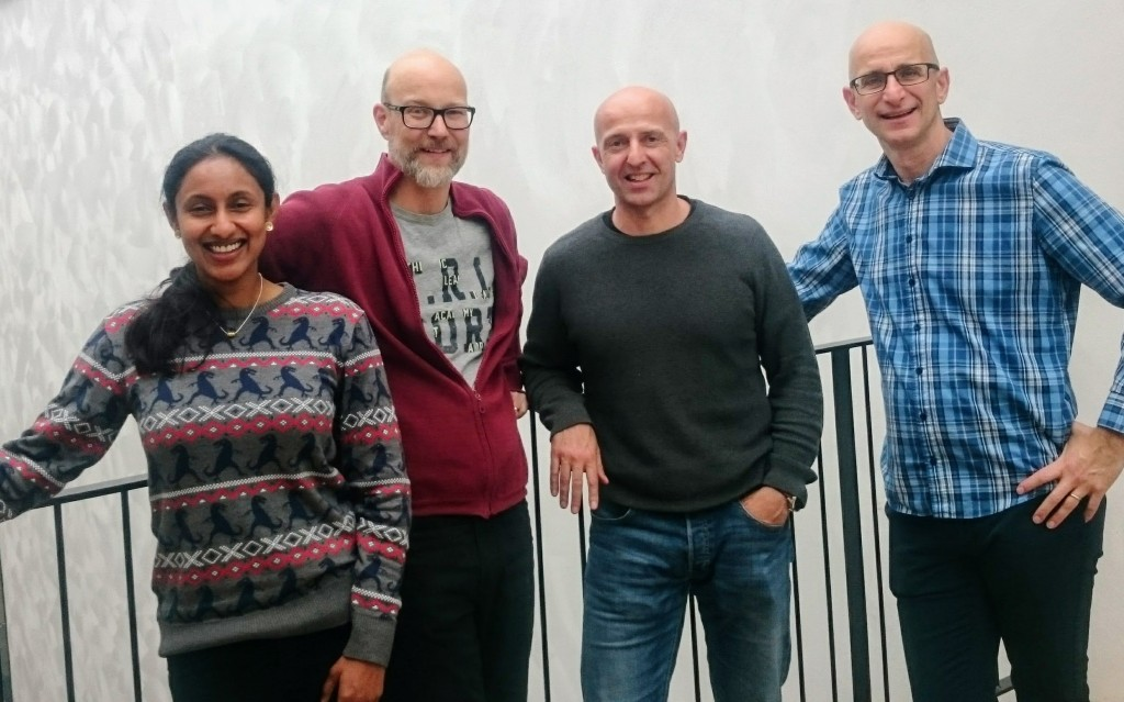 Hiranya Peiris, Jesper Sollerman, Stephan Rosswog, and Ariel Goobar are standing on one of the walking bridges between the two wings in the AlbaNova building.
